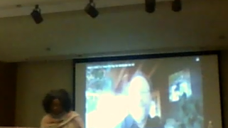 Lee McQueen shows pre-recorded video of Dr Gerald Friedman